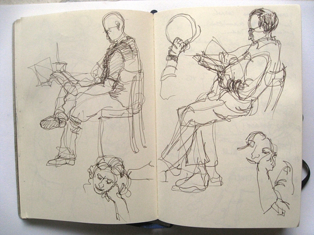 People sketching at a cafe